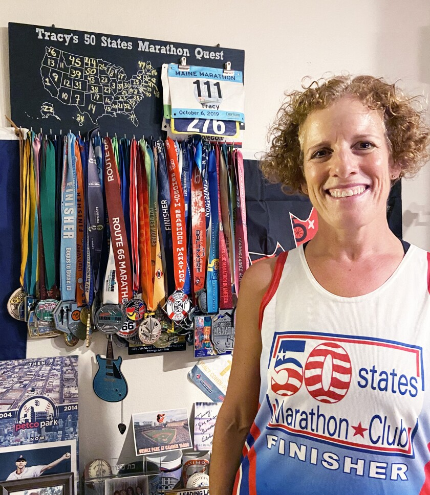 Tracy Roth, with her marathon completion medals from all 50 states.