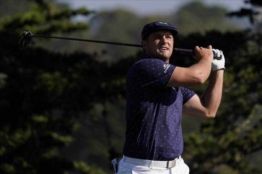 Bryson DeChambeau watches his tee shot on the 14th hole during the first round of the PGA Championship golf tournament at TPC Harding Park Thursday, Aug. 6, 2020, in San Francisco. (AP Photo/Jeff Chiu)