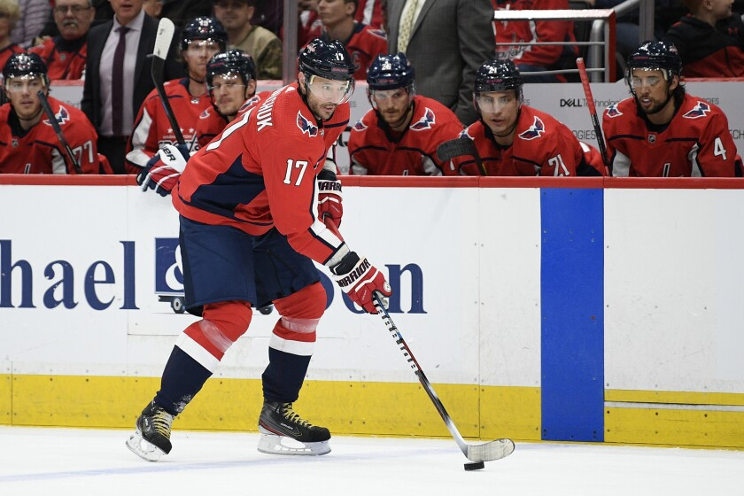 Washington Capitals left wing Ilya Kovalchuk, of Russia, skates with the puck during the first period of the team's NHL hockey game against the Winnipeg Jets, Tuesday, Feb. 25, 2020, in Washington. (AP Photo/Nick Wass)
