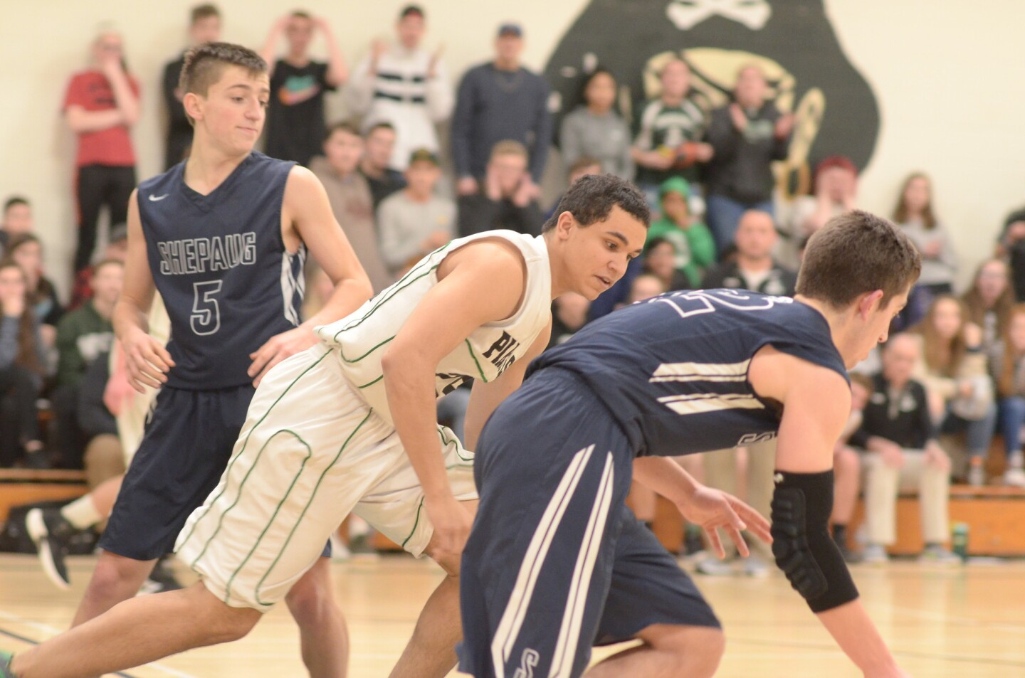 Parish Hill's Cameron Zaimoff keeps an eye on Shepaug Valley's Jack Schneider, during a state Class V second-round playoff game on March 7. Also shown at far left is Shepaug's Owen Hibbard.