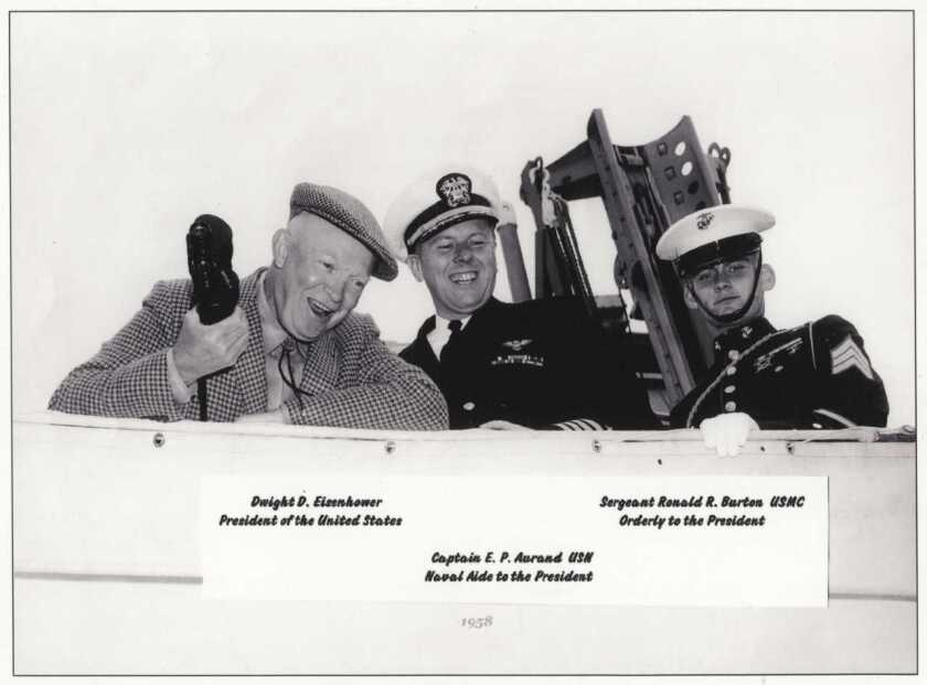 Capt. Ron Burton (then a sergeant) was selected to serve as the Marine orderly for President Dwight D. Eisenhower for a day, while the president was aboard the USS Mitscher to observe the 1958 America's Cup races off Newport Beach, Rhode Island. From left, President Eisenhower, Navy Capt. E. P. Aurand and Sgt. Burton. Courtesy of Ron Burton.