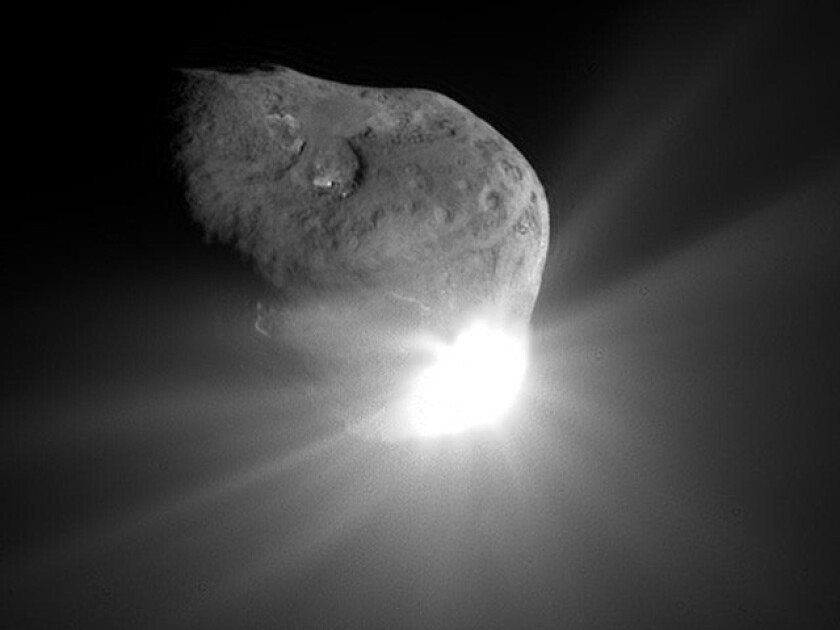 This spectacular image was taken by NASA's Deep Impact spacecraft 67 seconds after the onrushing comet Tempel 1 overtook and atomized the spacecraft's impactor on July 4, 2005.