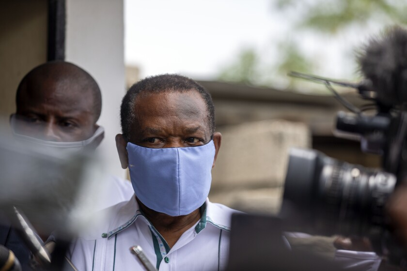 FILE - In this file photo dated Thursday, May 21, 2020, Yves Jean-Bart, president of the Haitian Football Federation, wearing a protective face mask, arrives for a court hearing regarding allegations that he abused female athletes at the country's national training center, in Croix-des-Bouquets, Haiti. In a verdict announced Friday Nov. 20, 2020, the FIFA ethics committee has found Jean-Bart guilty, banned him from the sport for life and fined him dollars 1.1 million, following accusations of systematic sexual abuse of female players. (AP Photo/Dieu Nalio Chery, FILE)