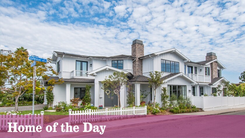 Designed by architect, Louie Tomaro with landscaping by Scott Martin, this two-story Colonial style sits on a corner lot with close proximity to the beach.