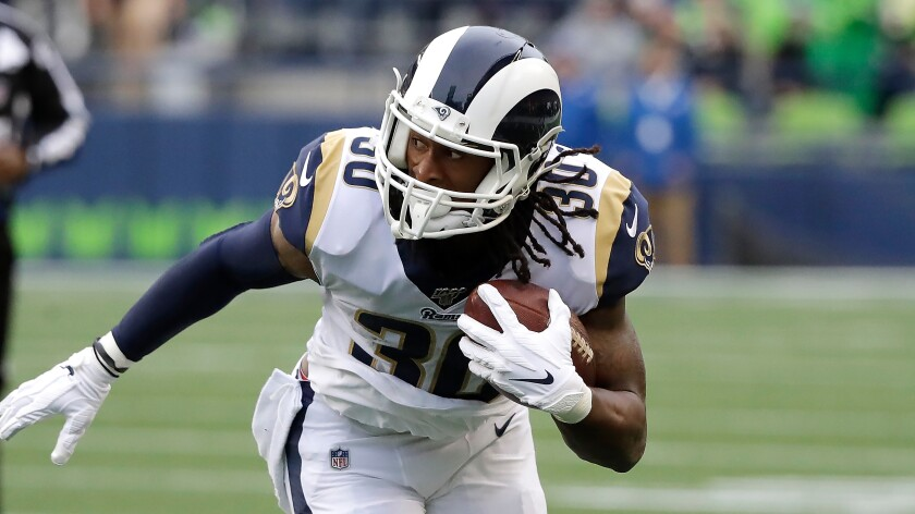 Rams running back Todd Gurley carries the ball against the Seahawks on Oct. 3, 2019, in Seattle.