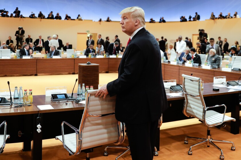 President Donald Trump arrives for a session during the G20 summit in Hamburg, Germany, on July 8, 2017. Legislation that would limit Trump's ability to lift financial sanctions on Russia is mired in a partisan dispute in the House.
