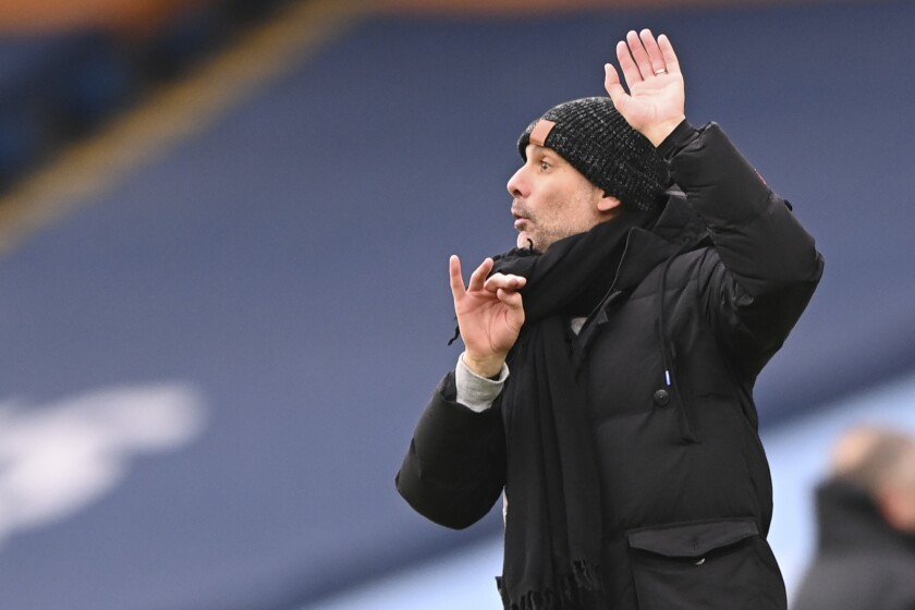 Manchester City's head coach Pep Guardiola reacts during the English Premier League match between Manchester City and Sheffield United at the the City of Manchester Stadium in Manchester, England, Saturday, Jan. 30, 2021. (Laurence Griffiths/Pool via AP)