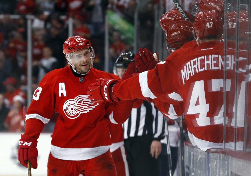 Detroit Red Wings center Pavel Datsyuk (13) celebrates his goal against the Florida Panthers in the third period of an NHL hockey game, Monday, Feb. 8, 2016 in Detroit. (AP Photo/Paul Sancya)