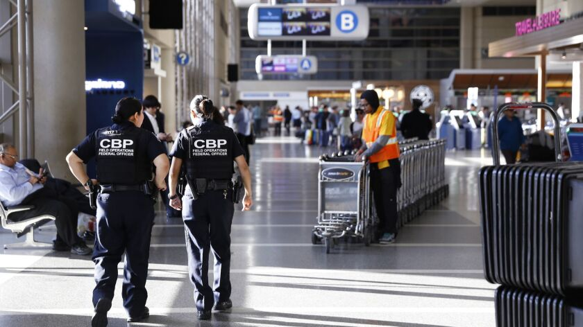 LOS ANGELES, CA - MARCH 16, 2017 - Travelers fill the Tom Bradley International Terminal at Los Ange