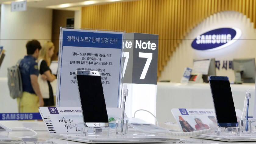 Powered-off Galaxy Note 7 smartphones are displayed Sunday at a Samsung service center in Seoul.