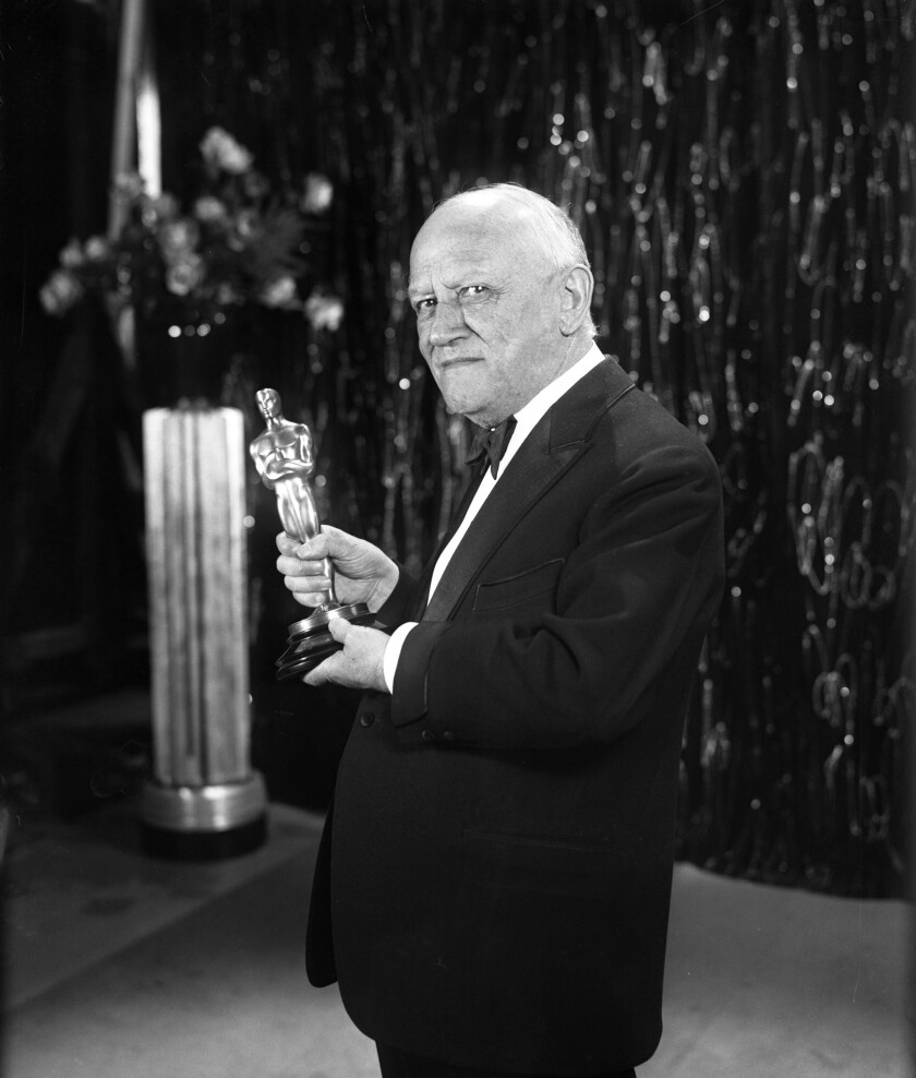Nov. 5, 1930: Founder and president of Universal Pictures, Carl Laemmle holds the Oscar for Outstand