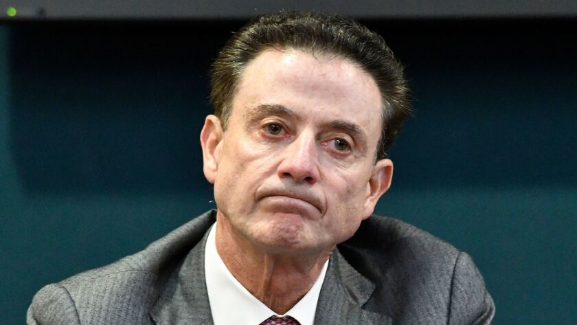 Louisville head basketball coach Rick Pitino reacts to a question during a press conference, Thursda