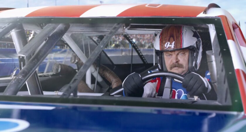 Nick Offerman trades some paint in NBC's Super Bowl commercial promoting its upcoming 2015 NASCAR coverage.