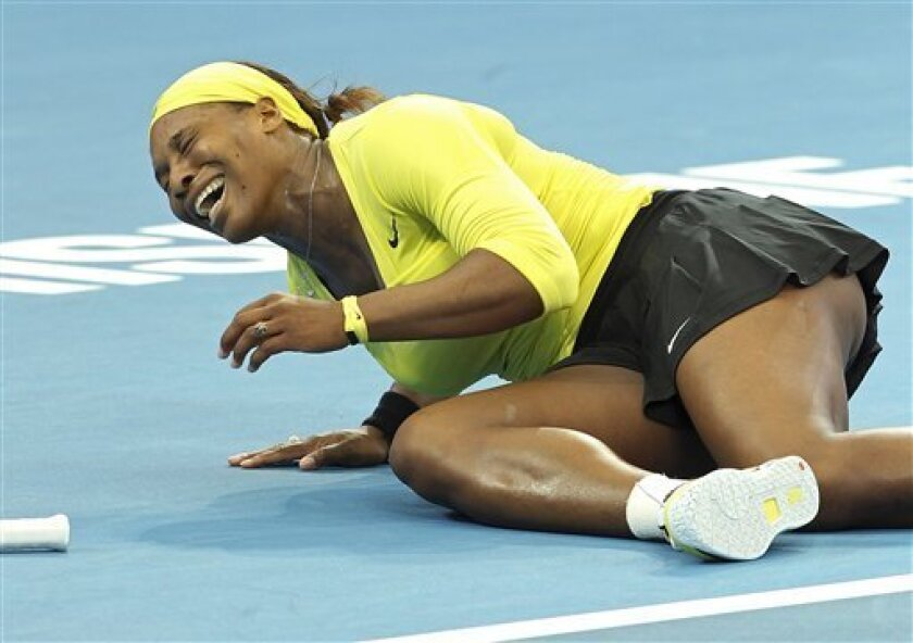 Serena Williams of the United States collapses after twisting her left ankle in her match against Bojana Jovanovski of Serbia during the Brisbane International tennis tournament in Brisbane, Australia, Wednesday, Jan. 4, 2012. (AP Photo/Tertius Pickard)