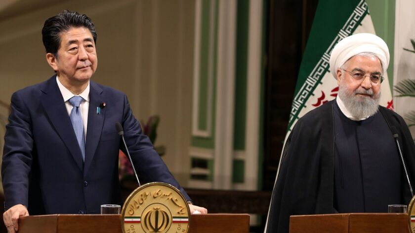 Japanese Prime Minister Shinzo Abe and Iranian President Hassan Rouhani at a joint news conference in Tehran on June 12.