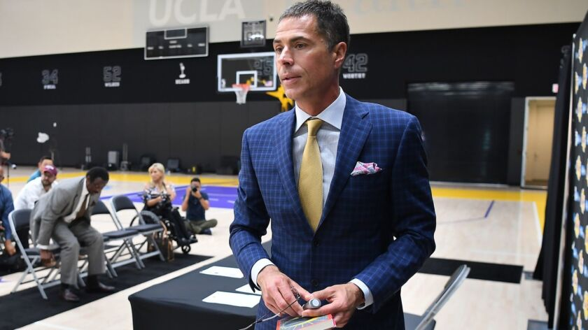 EL SEGUNDO, CALIFORNIA JULY 11, 2018-Lakers genral manager Rob Pelinka finishes a press conference t