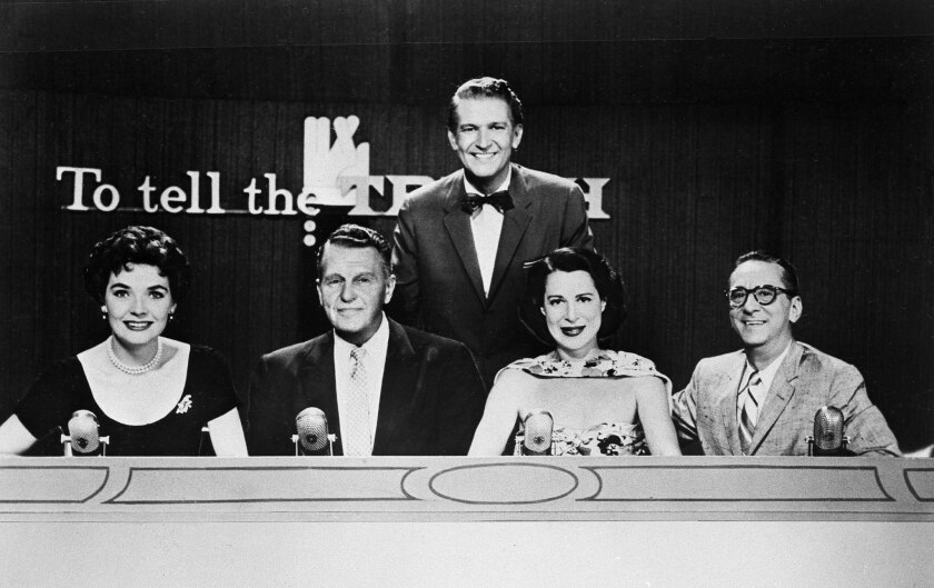 """Master of ceremonies Bud Collyer, rear, with the panel of CBS TV's """"To Tell The Truth"""" in 1957. The panelists, from left: Polly Bergen, Ralph Bellamy, Kitty Carlisle and Hy Gardner."""