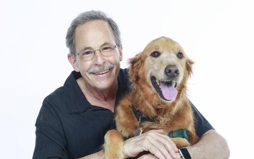 Author, speaker, and retired veterinarian Mark Goldstein, and Basil the golden retriever.