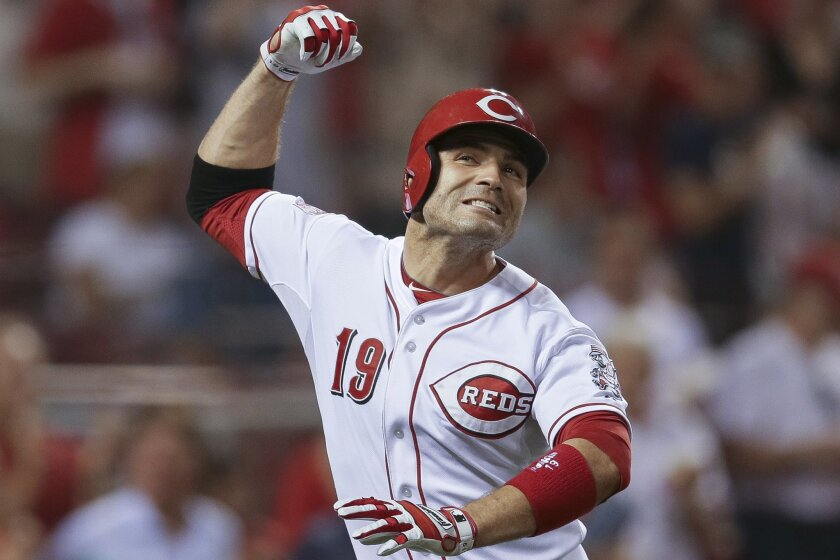 Cincinnati Reds' Joey Votto celebrates after hitting his third home run, in the seventh inning of a baseball game against the Philadelphia Phillies, Tuesday, June 9, 2015, in Cincinnati. The Reds won 11-2. (AP Photo/John Minchillo)