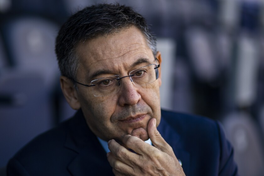 """FILE - In this Nov. 8, 2019, file photo, President of FC Barcelona Josep Bartomeu pauses during and interview with the Associated Press at the Camp Nou stadium in Barcelona, Spain. Spanish police entered Barcelona's stadium on Monday March 1, 2021 and detained some people in a search and seize operation related to an investigation into club officials. The operation was related to last year's """"Barçagate,"""" in which club officials were accused of launching a smear campaign against current and former players who were critical of the club and then-president Josep Maria Bartomeu. (AP Photo/Emilio Morenatti, File)"""