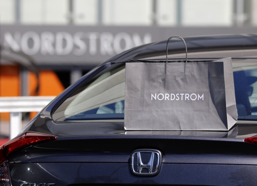 A Nordstrom service employee left an order for a customer on top of the car's trunk when the trunk did not open automatically at South Coast Plaza in Costa Mesa on Friday.