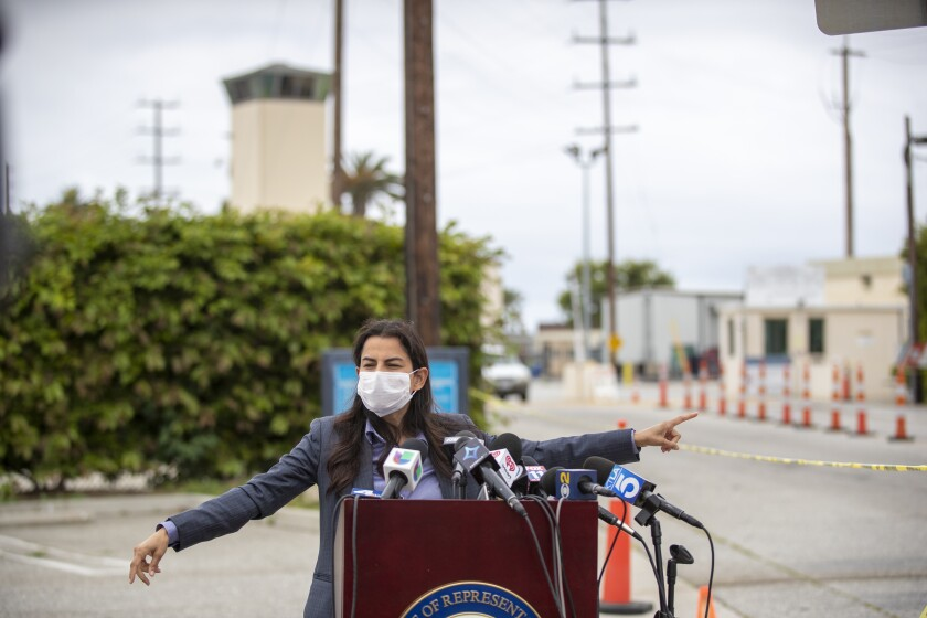 Rep. Nanette Barragan (D-San Pedro) speaks during a news conference after touring the federal penitentiary at Terminal Island to inquire about the high number of COVID-19 cases among inmates and prison staff.