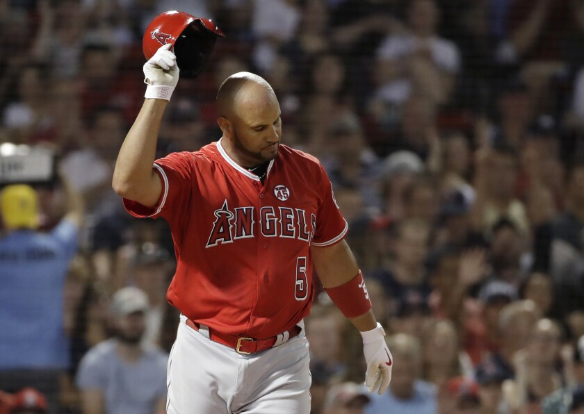 Angels' Albert Pujols tosses his helmet after striking out against Boston Red Sox starting pitcher Chris Sale during the seventh inning on Thursday in Boston.