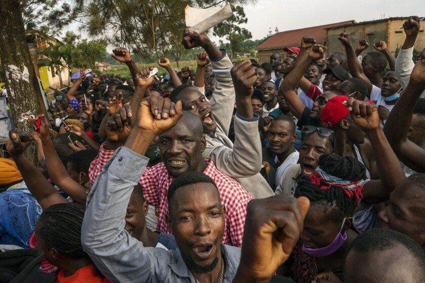 Supporters of leading opposition challenger Bobi Wine cheer