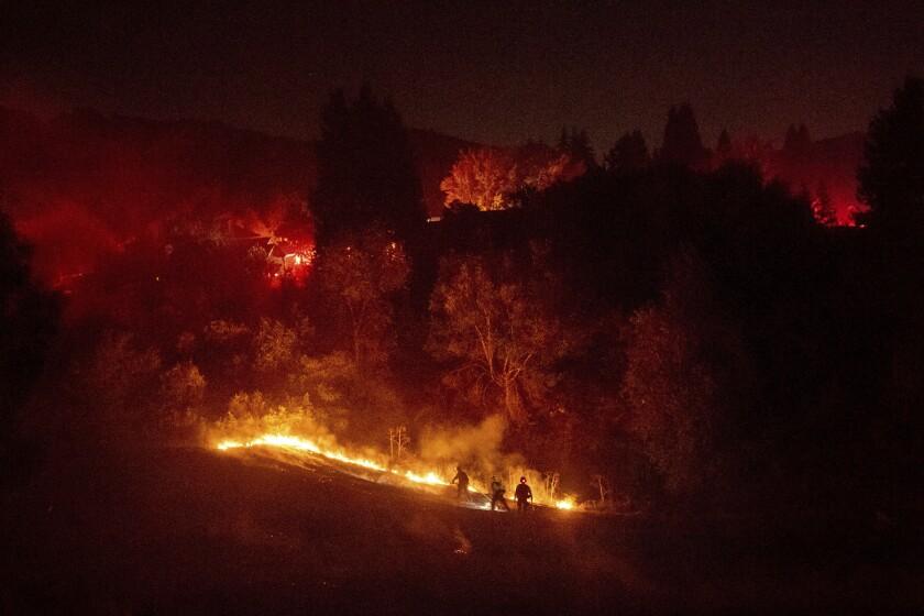 A brush fire burns in Moraga, Calif., on Thursday