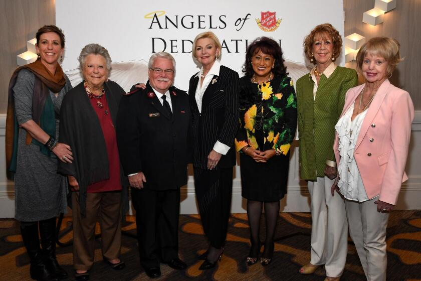 Mary Ann Beyster and Betty Beyster, Salvation Army divisional commander Major George Baker, Joye Blount, Delores McNeely and Jeri Rovsek with Women's Auxiliary president Pattie Wellborn