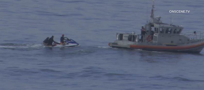 Lifeguards rescued 13 people from a beach in Sunset Cliffs after a small boat capsized May 18.