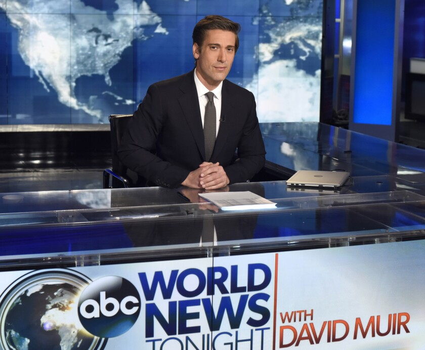 """This undated image released by ABC shows anchor David Muir on the set of """"World News Tonight with David Muir,"""" in New York. After five years at """"World News Tonight,"""" Muir has a milestone that's increasingly rare in television. His average audience is actually larger than it used be. ABC is finishing the TV season with its largest lead over NBC in 23 years, and 27 years for CBS. It's the third straight year ABC has won the ratings competition.(Ida Mae Astute/ABC via AP)"""