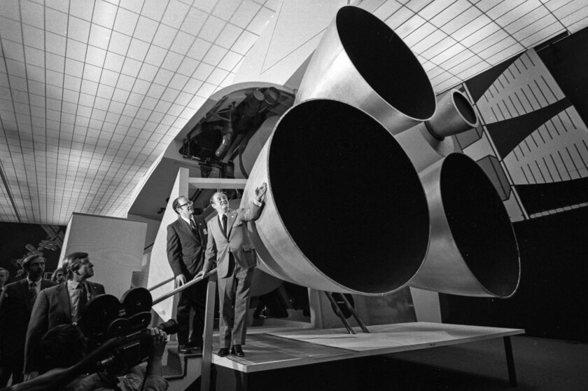June 5, 1972: Sen. Hubert H. Humphrey inspects mockup of engine section of space shuttle during visi