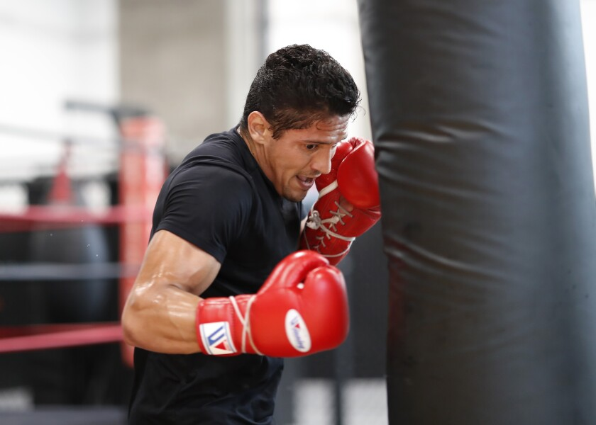 Giovani Santillan works out at The BXNG Club in downtown San Diego.