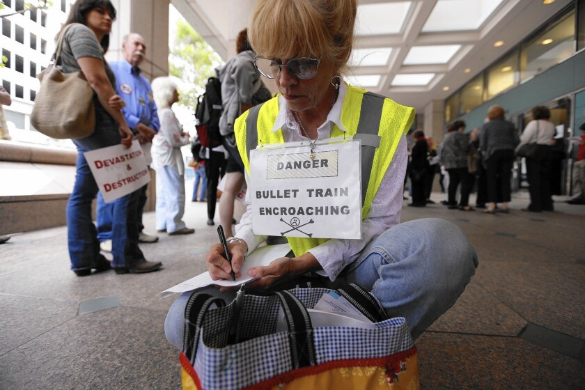 Shannon McGinnis of Kagel Canyon joins opponents of the current route for the high-speed rail line before they converge on a meeting of the California High-Speed Rail Authority on June 9.