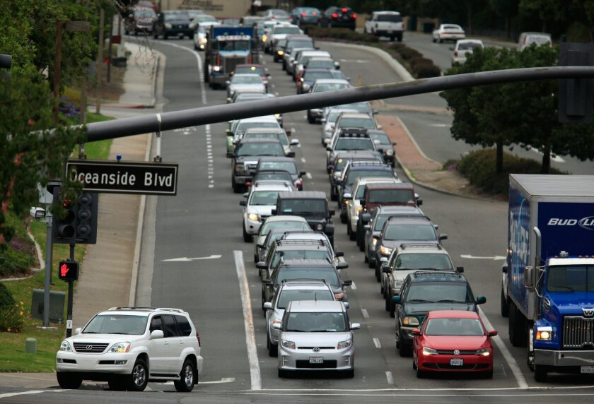 .Morning traffic begins to build going southbound toward State Route 78 at the intersection of College Boulevard and Oceanside Boulevard in Oceanside..