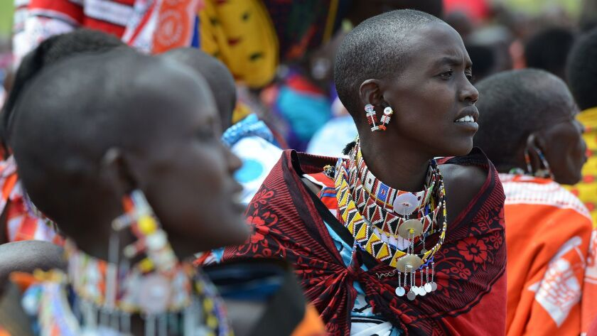Female genital mutilation remains a deeply embedded practice in some cultures. These Kenyan Masai women attended a meeting in 2014 where several participants voiced opposition to a ban on the practice.