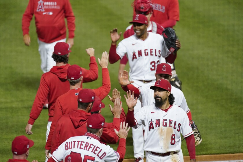 Angels celebrate their 6-1 win over the Kansas City Royals on Wednesday.