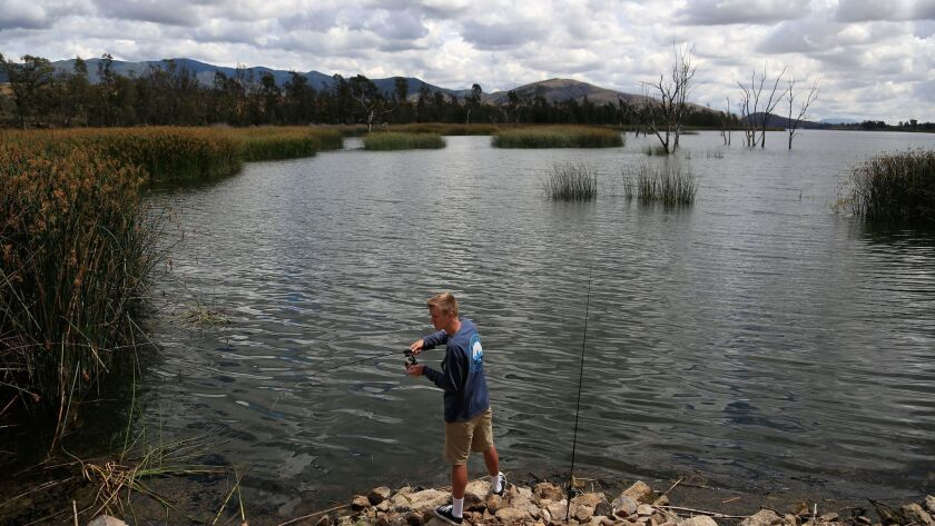 Derrick Dykes fishes for bass at Otay Lakes in Chula Vista