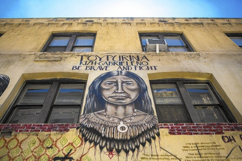 """Winston Street, known to some as """"Indian Alley,"""" is lined with murals."""