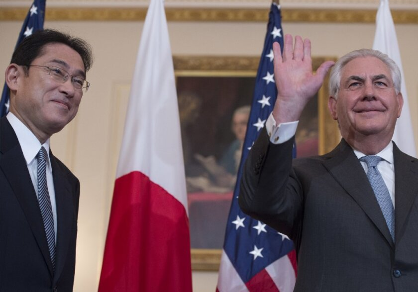 Secretary of State Rex Tillerson, right, and Japanese Foreign Minister Fumio Kishida greet reporters at the State Department last week.