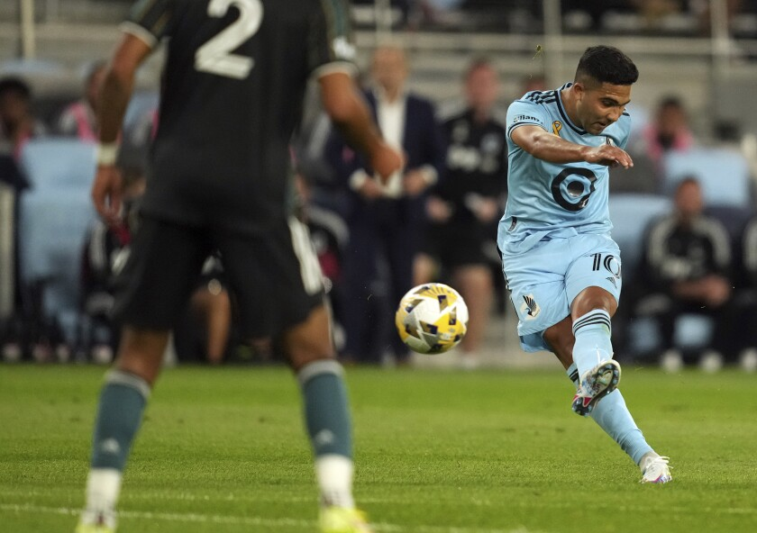 Minnesota United midfielder Emanuel Reynoso (10) shoots from outside to score against the LA Galaxy during the first half of an MLS soccer match Saturday, Sept. 18, 2021, in St. Paul, Minn. (Anthony Souffle/Star Tribune via AP)