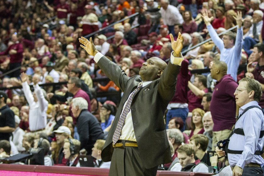 Florida State head coach Leonard Hamilton reacts to the referee not calling a foul in the second half of an NCAA basketball game against Miami in Tallahassee, Fla., Sunday Feb. 14, 2016. Miami defeated Florida State 67-65. (AP Photo/Mark Wallheiser)