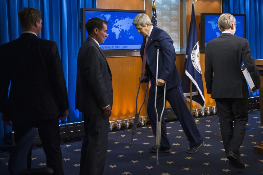 Secretary of State John F. Kerry leaves the lectern after presenting the State Department's annual human rights report in Washington. Kerry remains on crutches as he recovers from a bicycle accident.