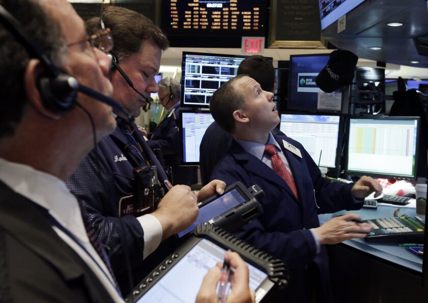 Fewer working Americans are counting on their 401(k) plans to be a major source of income in retirement, apparently because their confidence in the stock market has been shaken, a new poll shows. Above, the floor of the New York Stock Exchange.