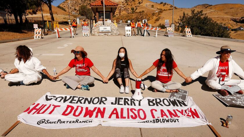 Protesters stage a sit-in at the entrance to Southern California Gas Co.'s Aliso Canyon storage facility in Porter Ranch in October, marking the two-year anniversary of the largest methane leak in U.S. history.