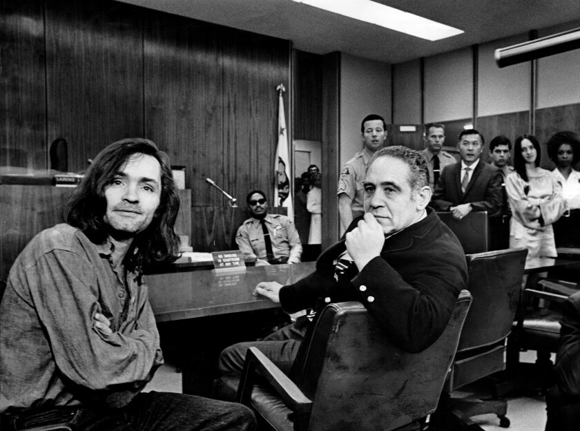 Charles Manson, left, sits in court with criminal defense attorney Irving Kanarek in 1970.