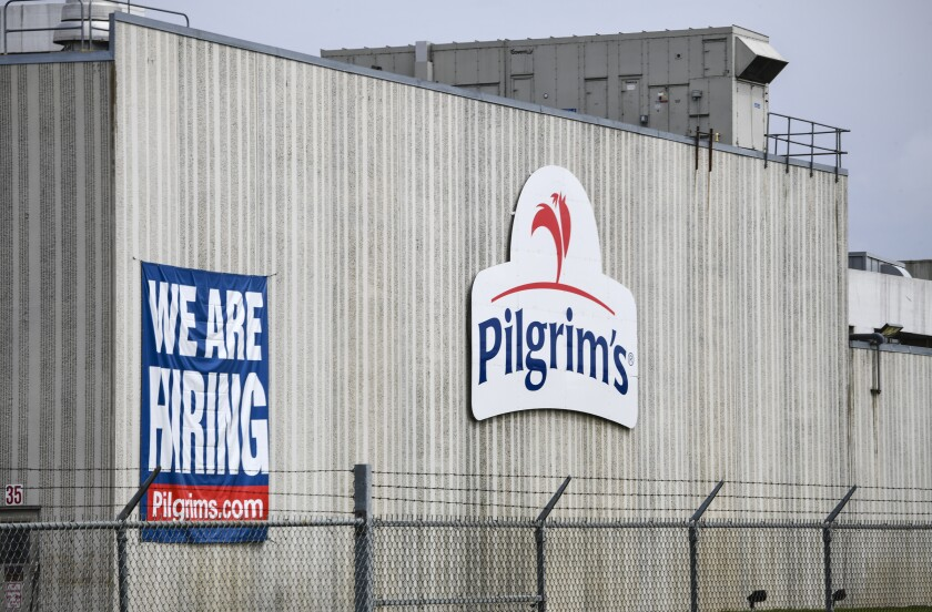 This April 28, 2020 file photo shows the Pilgrim's Pride plant in Cold Spring. Minn. A federal grand jury has charged four current and former chicken company executives with price-fixing. The U.S. Department of Justice says the executives from Colorado-based Pilgrim's Pride and Georgia-based Claxton Poulrty conspired to fix prices and rig bids for broiler chickens from at least 2012 to 2017.(Dave Schwarz/St. Cloud Times via AP)