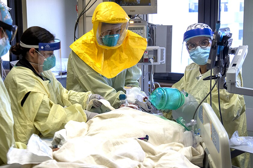 A COVID-19 patient is treated in the intensive care unit at Loma Linda University Medical Center.