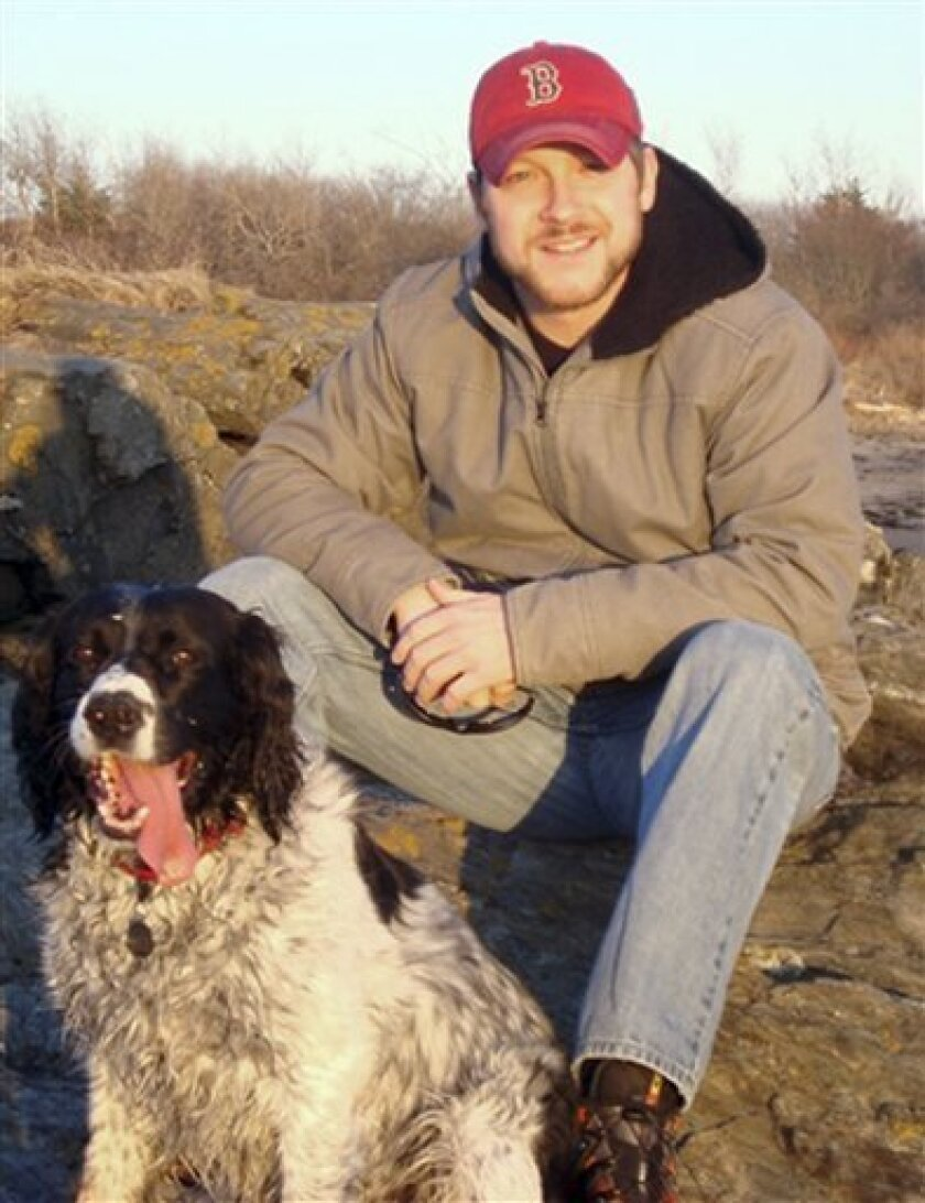 This March 2010 photo released by girlfriend Charlotte Stuart, shows Scott Hamann, a filmmaker from South Portland, Maine, with his dog Chief. Hamann, who had been hired to document aid vessels defying Israel's blockade of the Gaza Strip, is among those detained for deportation from Israel, his father and girlfriend said Tuesday, June 1, 2010. (AP Photo/Charlotte Stuart) NO SALES